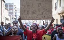 FILE: Economic Freedom Fighters protest the eviction of settlers from parastatal Denel's land near Nolungile Station in Khayelitsha outside the Western Cape High Court. Picture: Thomas Holder/EWN