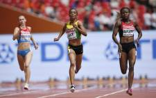 "Jamaica's Christine Day (C) and Kenya's Joyce Zakary compete in the heats of the women's 400 metres athletics event at the 2015 IAAF World Championships at the ""Bird's Nest"" National Stadium in Beijing on 24 August, 2015. Picture: AFP."