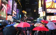 "Hundreds gather in Times Square, New York in support of Hong Kong's ""Umbrella Revolution"" on 1 October, 2014. Picture: AFP."
