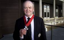 FILE: Former All Blacks head coach Sir Graham Henry poses after being Knighted by the Governor General of New Zealand Jerry Mateparae at Government House in Wellington on 3 May, 2012. Picture: AFP