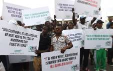 Protesters hold placards during an anti-government demonstration in Lagos, Nigeria on February 6, 2017. Picture: AFP