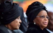 FILE: Winnie Madikizela Mandela and Graca Machel at the FNB Stadium for Nelson Mandela's memorial service on 10 December 2013. Picture: AFP