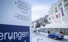 A car drives past a World Economic Forum sign on the streets of Davos on the first day of the 2017 forum. Picture: Reinart Toerien/EWN.