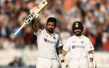 India's KL Rahul (left) raises his bat after scoring a century on day one of the second Test against England at Lord's on 12 August 2021. Picture: @BCCI/Twitter