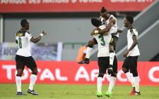 (L-R) Ghana's midfielder Emmanuel Agyemang Badu, Ghana's forward Asamoah Gyan, Ghana's defender Harrison Afful and Ghana's defender Daniel Amartey at the end of the 2017 Africa Cup of Nations group D football match. Picture: AFP.