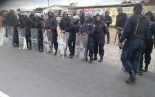 SAPS members seen during a protest by Bishop Lavis residents against gang violence on 12 September 2018. Picture: Amanda Davids/Facebook.com