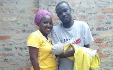 Ruben Niyogeshimi, his wife and one of their two children. Picture: Supplied