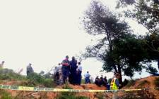 Police and rescue workers gather near a makeshift mine near Roodepoort where it's alleged a number of illegal miners were attacked, 7 January 2013. Picture: Mia Lindeque/EWN.