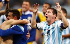 FILE: Lionel Messi and his team mates celebrate after beating the Netherlands which earned them a spot in the finals of the 2014 Fifa World Cup.