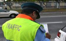 A Cape Town motorist is issued with a fine for driving unaccompanied with a learners licence on 22 March 2012. Picture: Aletta Gardner/EWN