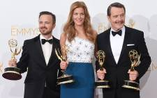 Emmy Award winners Aaron Paul, Anna Gunn and Bryan Cranston of Breaking Bad on 25 August 2014. Picture: AFP
