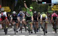Germanys Andre Greipel, wearing the best sprinters green jersey, celebrates as he crosses the finish line, ahead of Norways Alexander Kristoff (left), Great Britains Mark Cavendish (third left), Frances Arnaud Demare (fourth left), Germanys John Degenkolb (third right) and Slovakias Peter Sagan (second right), wearing the best youngs white jersey, at the end of the 189.5 km fifth stage of the 102nd edition of the Tour de France cycling race between Arras and Amiens, northern France. Picture: AFP.