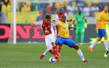 Ajax Cape Town's Travis Graham and Hlompho Kekana battle it out during the Nedbank Cup finals on 16 May 2015. Sundowns won on penalties. Picture: @OfficialPSL