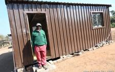 Man stands in front of housing unit in Talana, Tzaneen. Image: Limpopo Gov/Elvis Tshikhudo