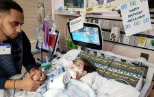 This photo courtesy of the Council on American-Islamic relations in Sacramento shows the young Abdullah Hassan on life support at UCSF Benioff Children's Hospital in Oakland on 16 December 2018 with his father, Ali. Picture: AFP