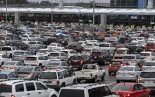 In this file photo taken on 12 March 2020 commuters heading to the United States line up on the Mexican side of the San Ysidro crossing port at the US-Mexico border in Tijuana, Baja California State, Mexico. The US will open land borders to vaccinated travelers in 'early November', a senior official said on 12 October 2021. Picture: AFP