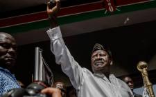Kenyan opposition National Super Alliance (NASA) coalition leader Raila Odinga gestures before swearing himself in as the 'people's president' on 30 January 2018 in Nairobi. Picture: AFP