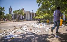 FILE: Striking cleaning staff at the University of the Western Cape tipped over bins and left litter strewn over the campus on 22 February 2016. Picture: Aletta Harrison/EWN.
