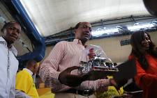 South African mining magnate Patrice Motsepe hands out christmas presents to underprivileged children in Soweto south of Johannesburg on 14 December 2015. Picture: Reinart Toerien/EWN.