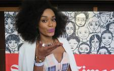 Nominated as a Cool Local Female Screen Star, Pearl Thusi blows a kiss to her fans. Photo: Louise McAuliffe/EWN Contributor