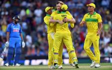 FILE: Australia's Jason Behrendorff (C) celebrates taking the wicket of India's Mahendra Singh Dhoni during the first one-day international (ODI) match between Australia and India at the Sydney Cricket Ground in Sydney on 12 January 2019. Picture: AFP