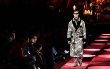 A model presents a creation for fashion house Dolce & Gabbana during its Men's Fall/Winter 2019/20 fashion show in Milan, on 12 January 2019. Picture: AFP