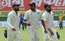India's Ravichandran Ashwin (C) talks with Murali Vijay (L) and Rohit Sharma (R) as they walk back to pavillion after victory over New Zealand during the fifth day of the first cricket Test match between India and New Zealand at Green Park Stadium in Kanpur on 26 September 2016. Picture: AFP