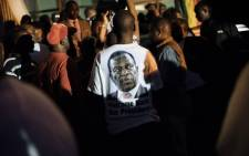 A supporter of Zimbabwe's incoming president Emmerson Mnangagwa wears a t-shirt with his portrait at Zimbabwe's ruling Zanu-PF party headquarters in Harare on 22 November, 2017. Picture: AFP