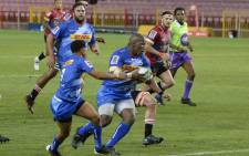 The Stormers' Scarra Ntubeni (C) runs with the ball during the second round match in the South African Super Rugby Unlocked competition between the Stormers and the Lions at Newlands Stadium in Cape Town on 17 October 2020. Picture: AFP