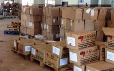 FILE: A photograph taken by DA leader in Limpopo, Desiree van der Walt, shows boxes abandoned in a hall, apparently full of undelivered textbooks on 3 April, 2014. Picture:Supplied.