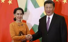 Myanmar State Counsellor Aung San Suu Kyi (L) shakes hands with Chinese President Xi Jinping during a meeting at the Great Hall of the People in Beijing on 16 May, 2017. Picture: AFP.
