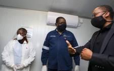 Gauteng Premier David Makhura (M) at the BMW Rosslyn plant in Pretoria. Picture: @David_Makhura/Twitter