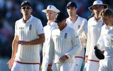 England's Alastair Cook (L) leads his players back to the pavilion as play finishes on the second day of the third Ashes cricket test match between England and Australia at Edgbaston in Birmingham, central England, on 30 July, 2015. Picture: AFP.
