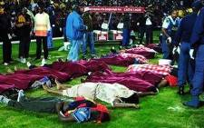 The bodies of soccer supporters lie on the pitch at Ellis Park Stadium in the worst stadium soccer disaster in South African history on 11 April 2001. Picture: PSL.