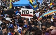 FILE: Venezuelan opposition activists protest against the government of President Nicolas Maduro, in Caracas, on 15 May, 2017. Picture: AFP