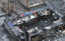 Indian police investigates among the charred remains of a restobar where a rooftop party was being held in Mumbai early on 29 December 2017. Picture: AFP.