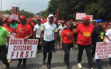 EFF leader Julius Malema (far left) leads his supporters on a march through Sandton to Eskom's headquarters to protest against load shedding the possible privatisation of the power utility on 28 February 2020. Picture: Edwin Ntshidi/EWN