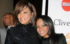 FILE: The late Whitney Houston and her late daughter Bobbi Kristina Brown in Beverly Hills in 2011. Picture: Getty Images/AFP.