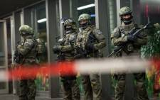 """Police outside the Munich train station on 31 December 2015 after they had """"indications that a terror attack"""" was being planned for New Year's Eve in Munich. Picture: AFP."""