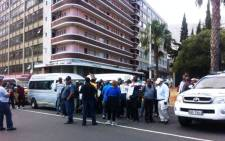 Traffic officials block a group of taxi drivers near Parliament on 20 November 2014. Picture: Carmel Loggenberg/EWN.