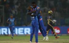 Kagiso Rabada and Shikhar Dhawan celebrate a wicket during Delhi Capitals' Indian Premier League clash with Kolkata Knight Riders. Picture: @DelhiCapitals/Twitter.
