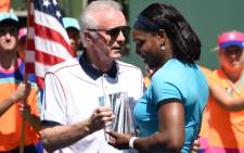 This file photo taken on 20 March 2016 shows Indian Wells Tennis Garden CEO Raymond Moore (L) presenting the second place trophy to Serena Williams of USA after the women's final of the BNP Paribas Open at the Indian Wells Tennis Garden in Indian Wells, California. Picture: Robyn Beck / AFP.