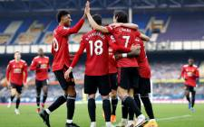 FILE: Manchester United striker Edinson Cavani celebrates scoring his team's third goal with teammates during the English Premier League football match between Everton and Manchester United at Goodison Park in Liverpool, north-west England on 7 November 2020. Picture: AFP