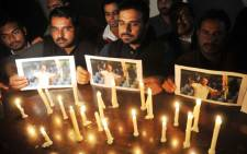 FILE: Pakistani cricket fans light candles and hold pictures of Australian cricketer Philip Hughes during a memorial in Multan, Pakistan, 28 November 2014. Picture: EPA.