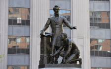 "The Abraham Lincoln Statue, erected in 1879, by Thomas Ball, is viewed in Park Square in Boston, Massachusetts on June 16, 2020. The statue is a copy of the ""Emancipation Memorial"" in Washington DC and represents Lincoln freeing African American slaves at the end of the US Civil War. Picture: AFP."