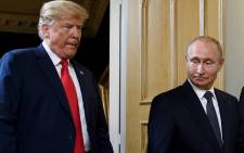 In this file photo taken on 16 July 2018 US President Donald Trump (L) and Russian President Vladimir Putin arrive for a meeting in Helsinki. Picture: AFP.
