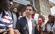 Madagascar presidential candidate Andry Rajoelina talks to media after casting his ballot in Antananarivo on 7 November 2018. Picture: AFP