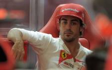 Ferrari's Spanish driver Fernando Alonso sits in the pits at the Valencia Street Circuit on June 22, 2012 in Valencia. Picture: AFP