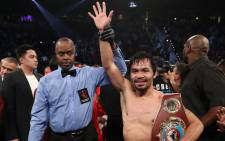 Manny Pacquiao of the Philippines poses after his unanimous-decision victory over Jessie Vargas at the Thomas & Mack Center on November 5, 2016 in Las Vegas, Nevada. Picture: Getty Images/AFP.