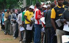Thousands of Zimbabweans queue outside the Pretoria Showgrounds on 31 December 2010 to apply for work, study & residency permits.